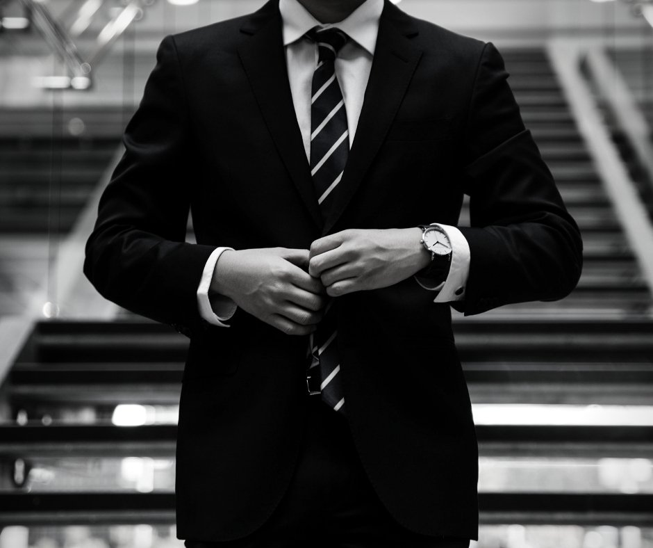 Black and white photo of a person in a business suit